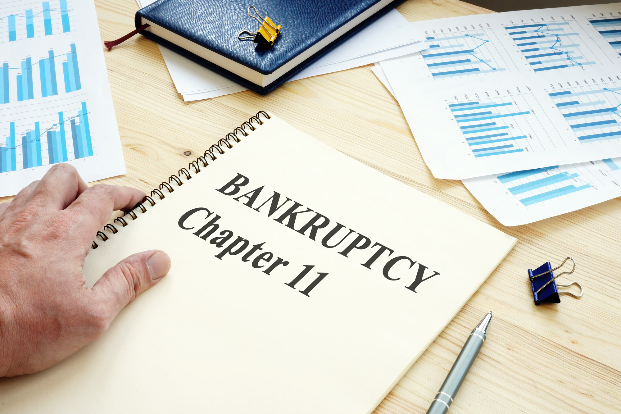 Businessman reads Bankruptcy Chapter 11 book.